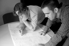 DH Ryan photo of Donal & Hugh working on design plans